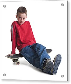 A Caucasian Boy In Jeans And A Red Sweater Sits On His Skateboard And Smiles Slightly Acrylic Print by Photodisc