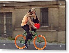 A Couple Biking Through The City Acrylic Print by Justin Case