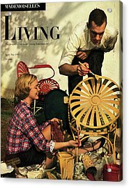 A Couple Painting A Chair Acrylic Print by Herman Landshoff