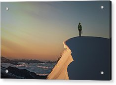 A Female Climber On A Snowy Mountaintop Acrylic Print by Buena Vista Images