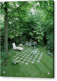 A Garden With Checkered Pavement Acrylic Print by Pedro E. Guerrero