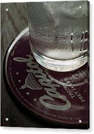 A Glass On A Coaster Acrylic Print by Romulo Yanes