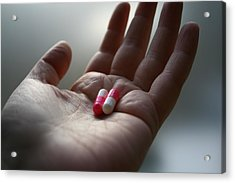 A Hand Holding Two Pills Acrylic Print by Red Sky