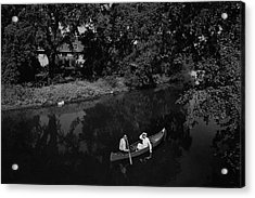 A Man And Woman In A Canoe On A Lake Acrylic Print