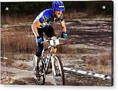 A Man Rides Aggressively Up A Muddy Acrylic Print
