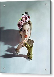 A Model Applying Lipstick Acrylic Print by John Rawlings