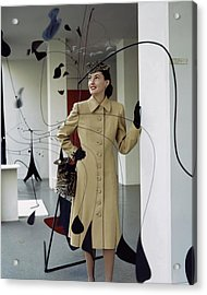 A Model Behind Calder Mobiles At The Museum Acrylic Print by John Rawlings
