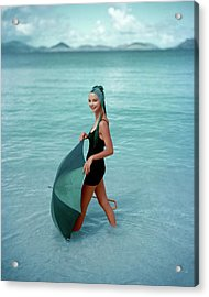 A Model In The Sea With An Umbrella Acrylic Print by Richard Rutledge