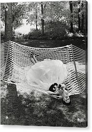 A Model Lying On A Hammock Acrylic Print by Gene Moore