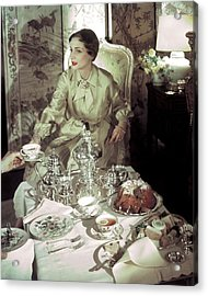 A Model Sitting In A Lavish Dining Room Acrylic Print