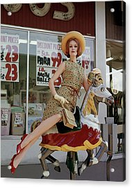 A Model Sitting On A Rocking Horse Acrylic Print by George Barkentin