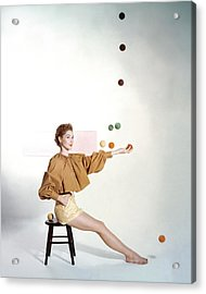 A Model Sitting On A Stool Juggling Acrylic Print
