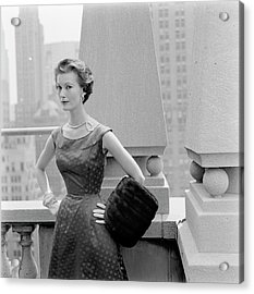 A Model Standing Against A Rooftop Column In An Acrylic Print