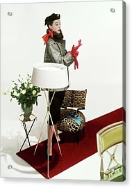 A Model Surrounded By Assorted Furniture On A Red Acrylic Print