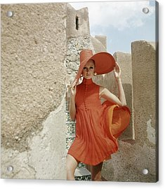 A Model Wearing A Orange Dress Acrylic Print by Henry Clarke