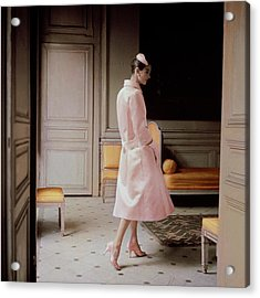 A Model Wearing A Pink Coat Acrylic Print by Karen Radkai