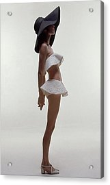 A Model Wearing A Two Piece Bathing Suit Acrylic Print by Bert Stern
