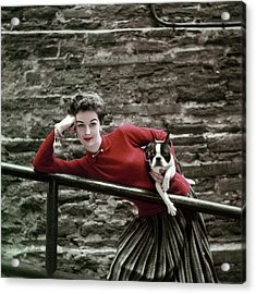 A Model With A Dog Leaning On A Railing Acrylic Print by Richard Rutledge