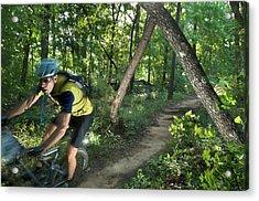 A Mountain Biker Speeds Down A Winding Acrylic Print