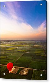 A Red Hot Air Balloon Landing In Egyptian Fields Acrylic Print by Mark E Tisdale