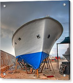 Acrylic Print featuring the photograph a resting boat in Jaffa port by Ron Shoshani