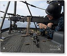 A Sailor Fires An M-240b Machine Gun Acrylic Print by Stocktrek Images