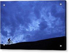 A Silhouette Of A Woman Mountain Biking Acrylic Print