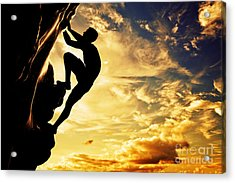 A Silhouette Of Man Free Climbing On Rock Mountain At Sunset Acrylic Print