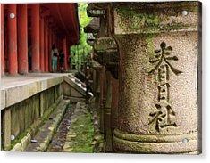 A Stone Pillar Which Reads Kasuga Acrylic Print by Paul Dymond