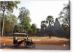 A Tuk Tuk Drives Past The Bayon In Siem Acrylic Print