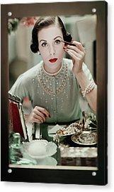 A Woman Applying Make-up Acrylic Print