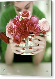 A Woman Holding A Bowl Of Roses Acrylic Print by John Rawlings