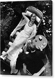 A Woman In A Chiffon Tea Gown In A Chaise Longue Acrylic Print