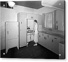 A Woman In Her Kitchen Acrylic Print by Underwood Archives