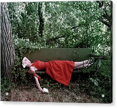 A Woman Lying On A Bench Acrylic Print by John Rawlings