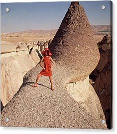 A Woman Modeling A Red Dress In Goreme Acrylic Print by Henry Clarke