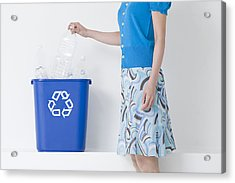 A Woman Putting A Bottle In A Recycling Bin Acrylic Print by Image Source