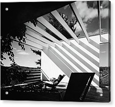 A Woman Sitting On A Reclining Chair On A Rooftop Acrylic Print