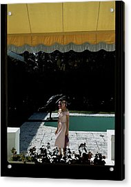 A Woman Walking Beside Her Swimming Pool Acrylic Print