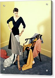 A Woman With Assorted Pieces Of Fabric Acrylic Print