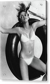 A Young Woman Floating On An Inner Tube Acrylic Print
