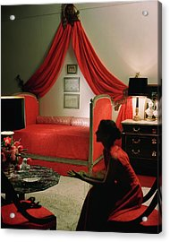 A Young Woman Sitting In A Red Bedroom Acrylic Print