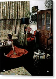 A Young Woman Sitting On The Floor In The Living Acrylic Print