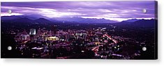 Aerial View Of A City Lit Up At Dusk Acrylic Print by Panoramic Images