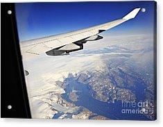 Airplane Wing Over Snowy And Rocky Coastline Acrylic Print by Sami Sarkis