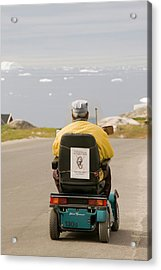 An Inuit Man In A Mobility Scooter Acrylic Print by Ashley Cooper