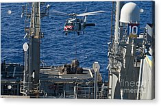 An Mh-60s Sea Hawk Delivers Supplies Acrylic Print by Stocktrek Images