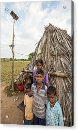 An Untouchable Family Outside Their Hut Acrylic Print by Ashley Cooper
