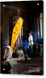 Angkor Wat Devotee Lights Incense In Buddha Temple Acrylic Print