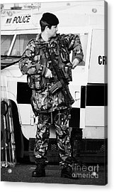 Armed British Soldier At Psni Landrover On Crumlin Road At Ardoyne Shops Belfast 12th July Acrylic Print by Joe Fox